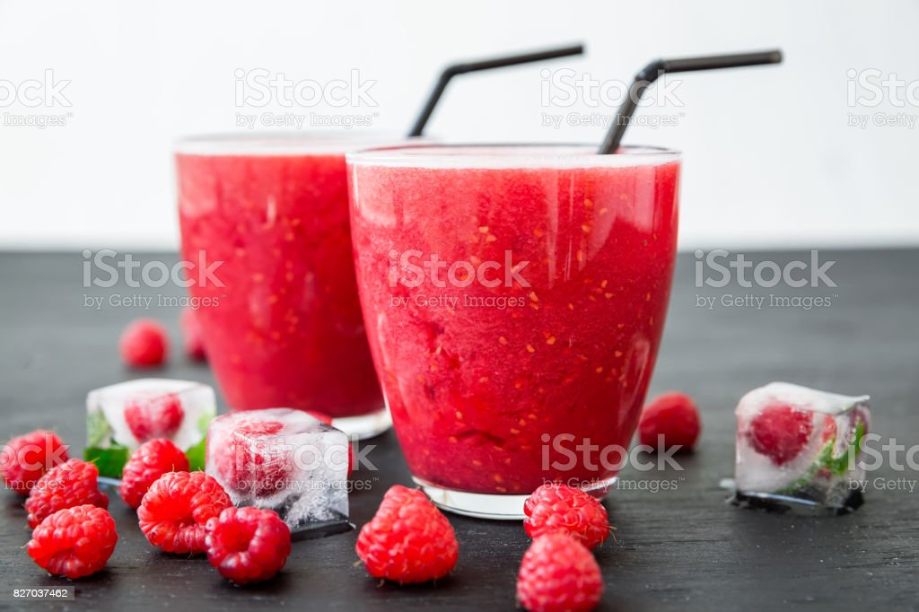 Jelly Panna cotta with fruit syrup and tasty berries in a plates. Traditional Italian dessert. stock photo