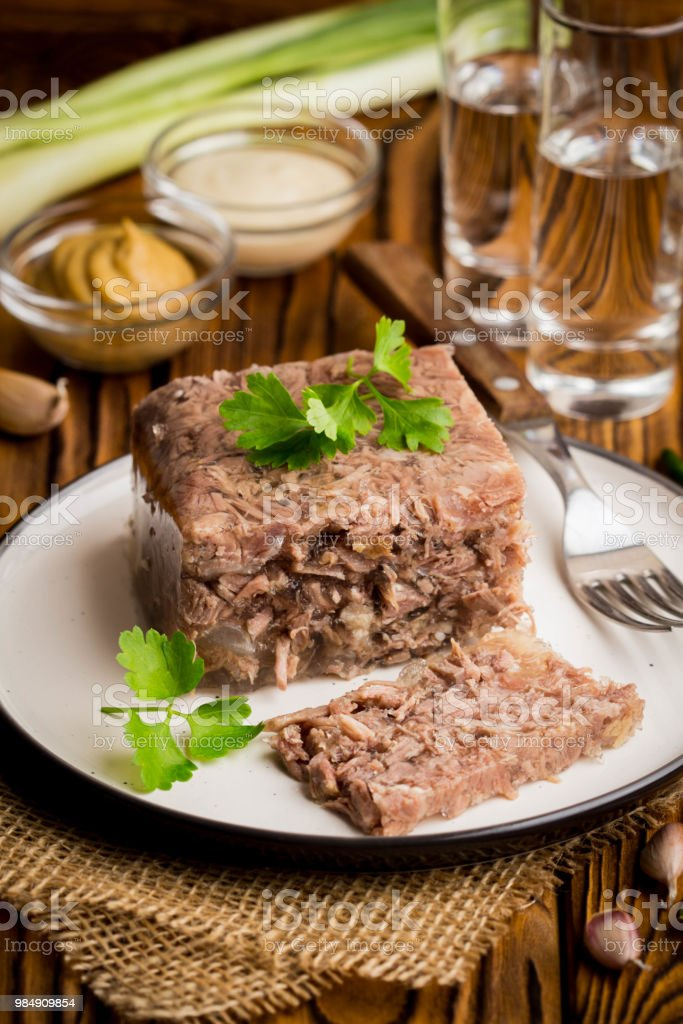Jelly with meat, beef aspic, traditional Russian dish, portion on a...