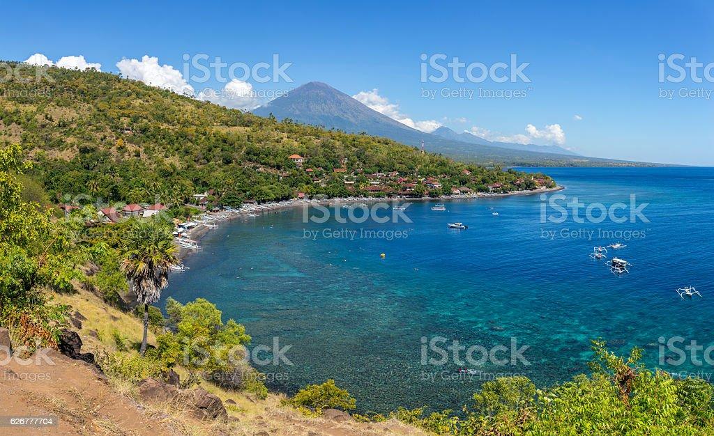 Jemeluk Beach and beautiful blue lagoon stock photo