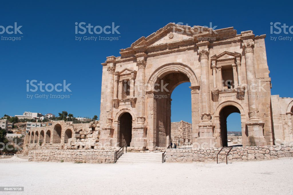 Jerash: the Arch of Hadrian, a triumphal arch built for the visit of the Emperor Hadrian in 129 AD in the archaeological city of Jerash, one of the world's largest sites of Roman architecture stock photo