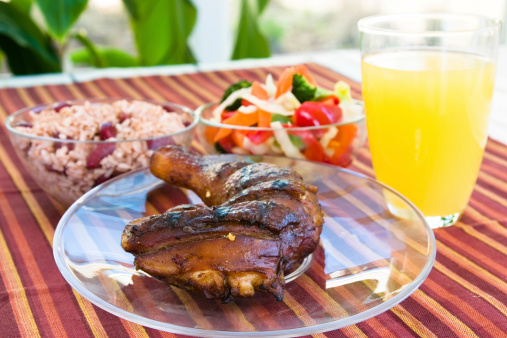 Jerk Chicken With Vegetables Rice And Lemonade Stock Photo - Download Image Now