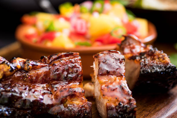 jerk pork belly - caribbean food stock photos and pictures