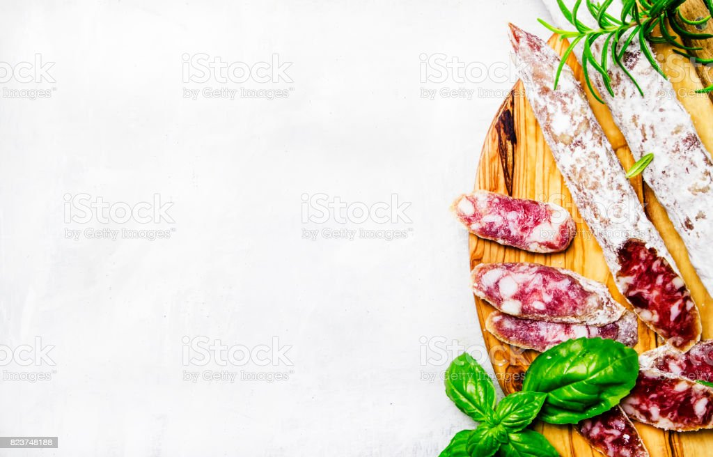 Jerked spanish sausages from pork with basil and rosemary, top view stock photo