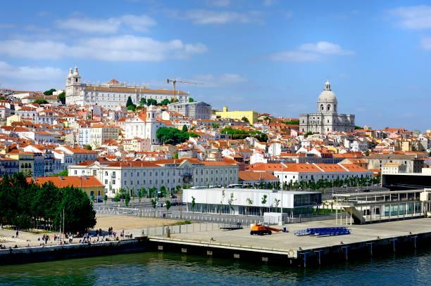 jerónimos monastery high on the hill in lisbon - rain clouds porto portugal imagens e fotografias de stock