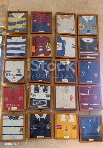Rocamadour, France - September 3, 2018: Jerseys from famous rugby players  have been offered in ex voto in the chapel of Notre Dame de l'Ovalie, dedicated to rugby players  at  Basilica of St-Sauveur in Rocamadour, France