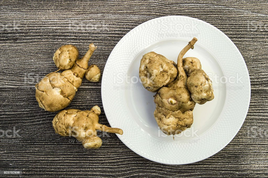 Jerusalem artichoke in different ways, interesting and, in the plate stock photo