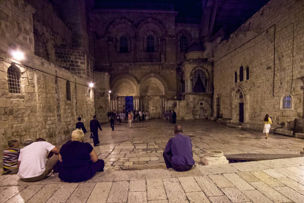 Jerusalem, Israel - circa :  All privileges and duties in the church are arranges by over 160 years old rules and regulation decree - so called Status Quo All privileges and duties of all Christian denominations present in the church are arranged by over stock photo