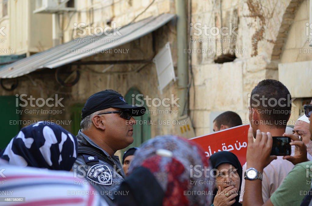 Jerusalem: Israeli border policeman among a group of Muslim demonstrators stock photo