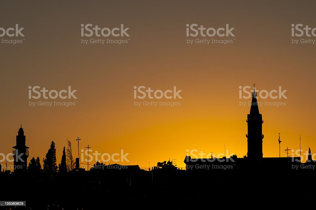 Jerusalem Old City sunset with minaret and church tower silhouetted royalty-free stock photo