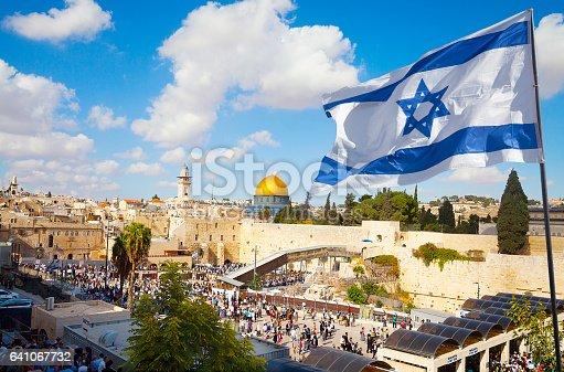 istock Jerusalem old city Western Wall with Israeli flag 641067732