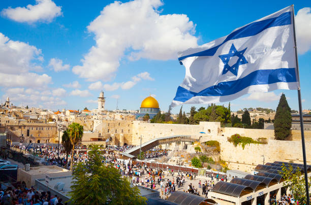 Jerusalem old city Western Wall with Israeli flag Israel flag with a view of old city Jerusalem and the KOTEL- Western wall judaism stock pictures, royalty-free photos & images