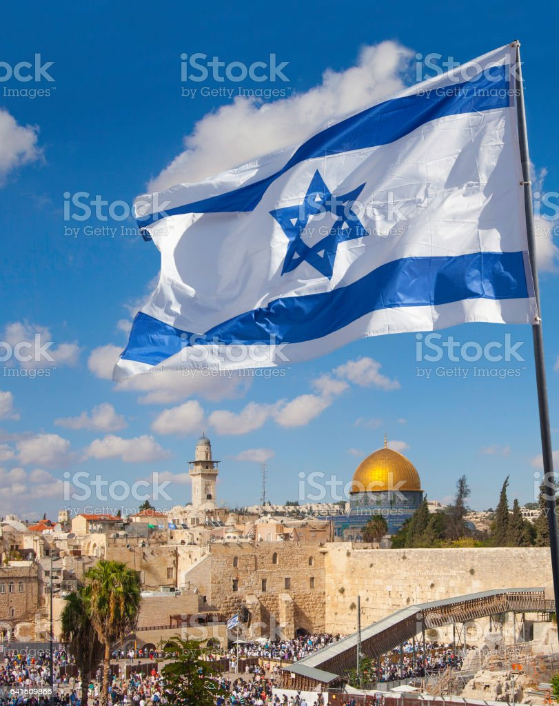 Jerusalem old city Western Wall with Israeli flag stock photo