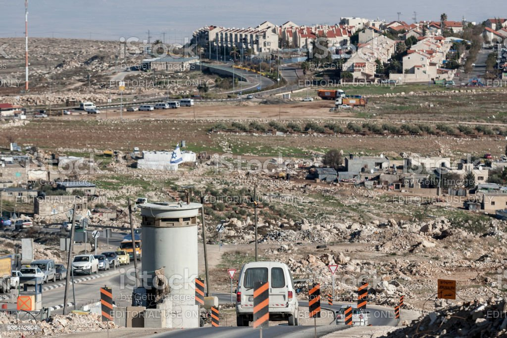 Jerusalem, Palestine, January 12, 2011: Road check point leading to Jewish settlement built on the grounds which are recognized as Palestinian Occupied Territories by international law, and seen as illegal, east of Jerusalem. stock photo
