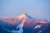 istock Jested Mountain and Jested Ski Resort in morning sunrise time. Clear sky and freezy winter time mood. Liberec, Czech Republic 1138640974