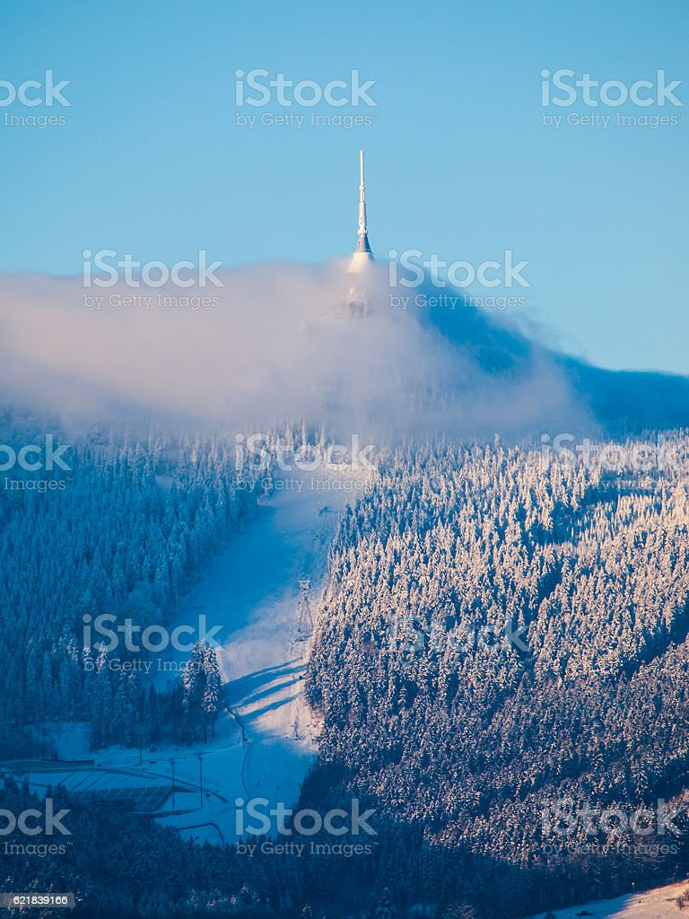 Jested transmitter and mountain hotel hidden in the clouds stock photo
