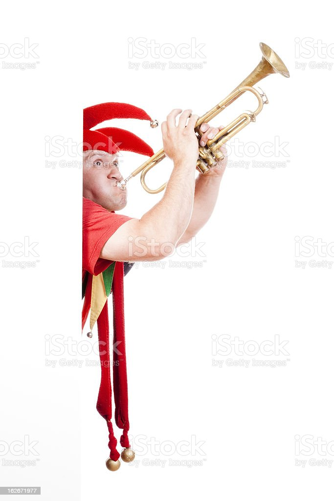 jester blowing trumpet royalty-free stock photo