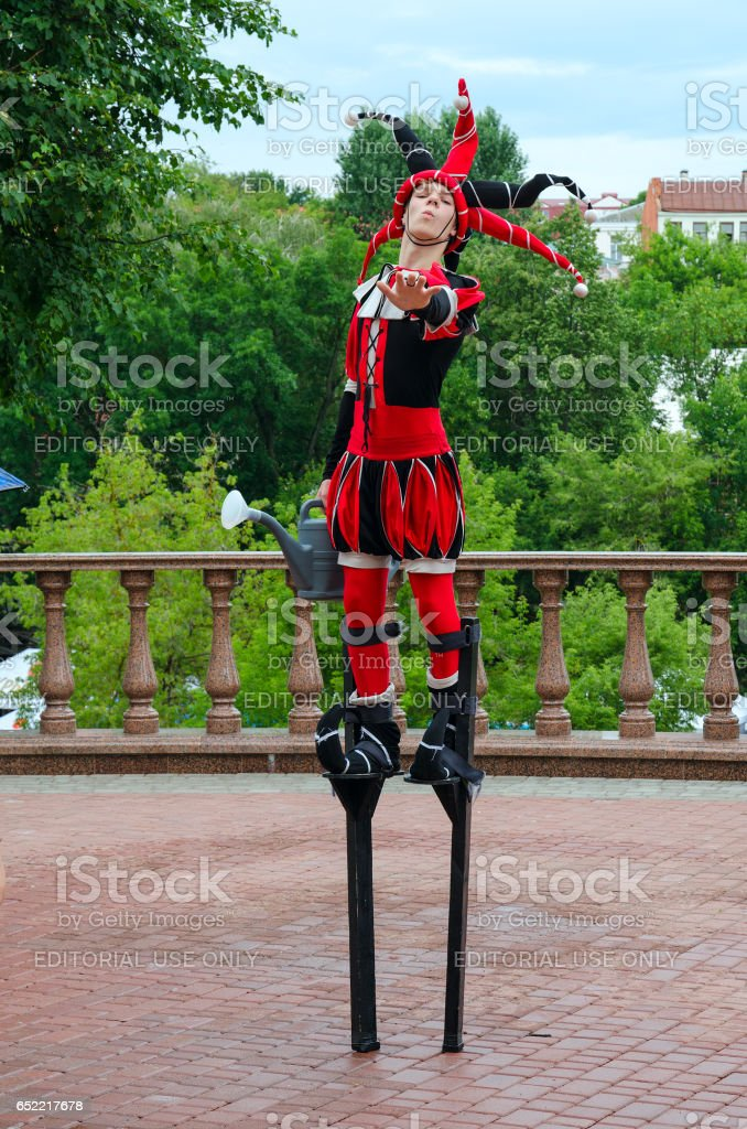 Jester on stilts during festival Slavic Bazaar, Vitebsk, Belarus stock photo
