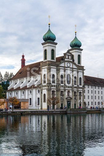 Jesuit Church (1667-1673) first large baroque church north from Alps, and Reuss river, Lucerne, Switzerland