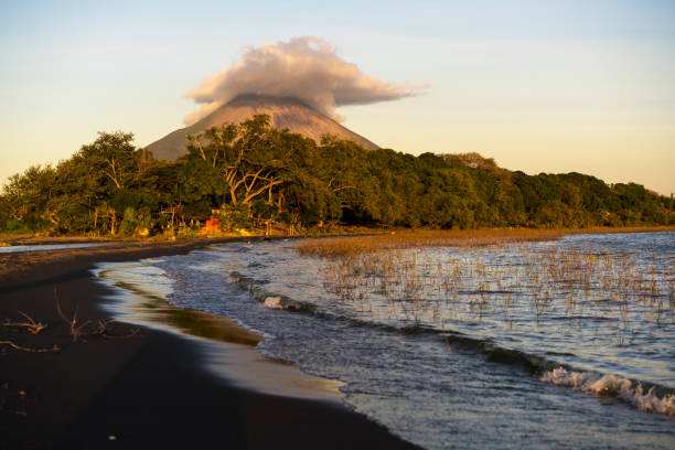 Jesus and Mary beach on island Ometepe in Lake Nicaragua with volcano in background, Nicaragua stock photo