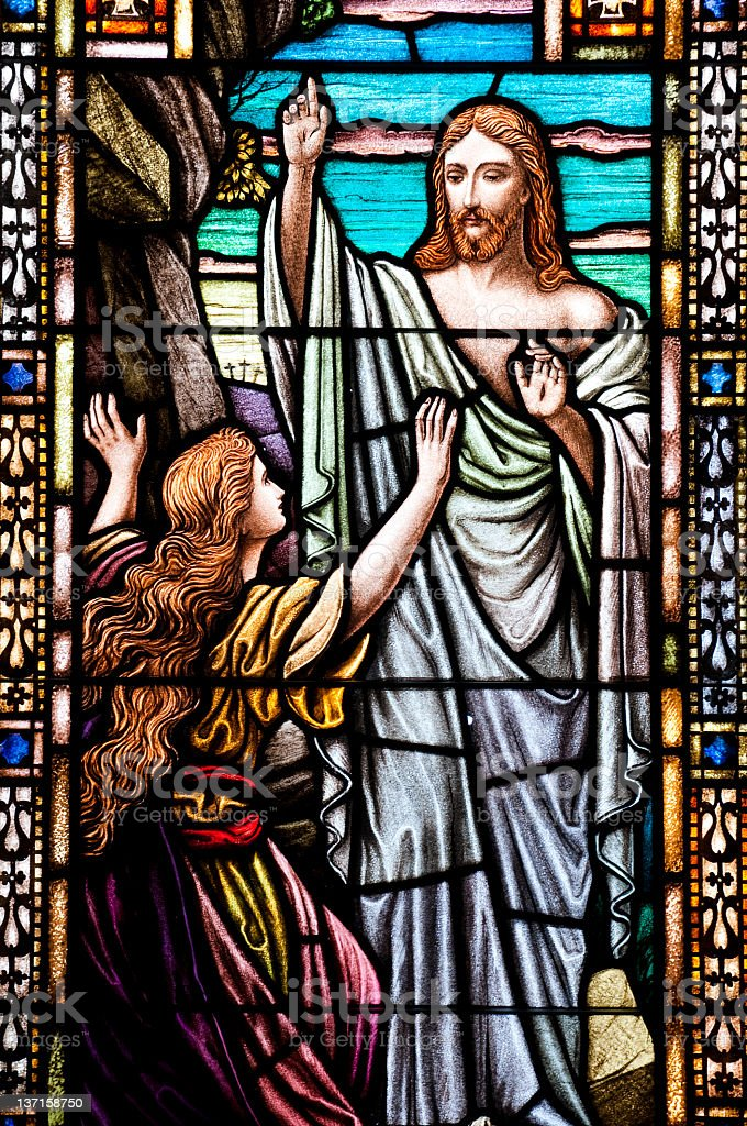 Jesus and Mary Magdalene after Jesus' resurrection in stained glass stock photo