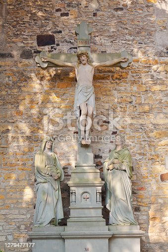 Jesus Christ at cross of wall of cathedral Osnabrueck  in inner courtyard of Dom St Petrus