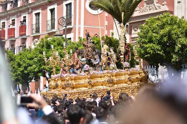 jesus kristus bärs på axeln i processioner - easter procession spain bildbanksfoton och bilder