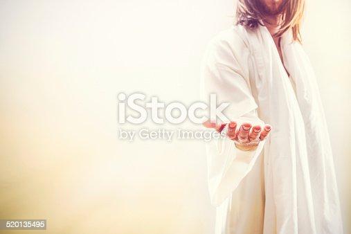 istock Jesus Christ Extending Welcoming Hand 520135495