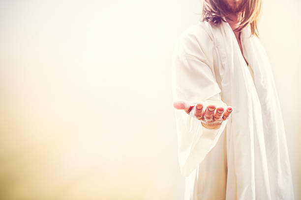jesus christ extending welcoming hand - heaven stock photos and pictures