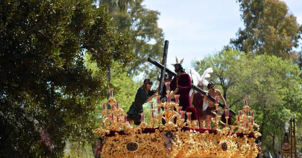 jesus kristus går till korsfästelsen - easter procession spain bildbanksfoton och bilder