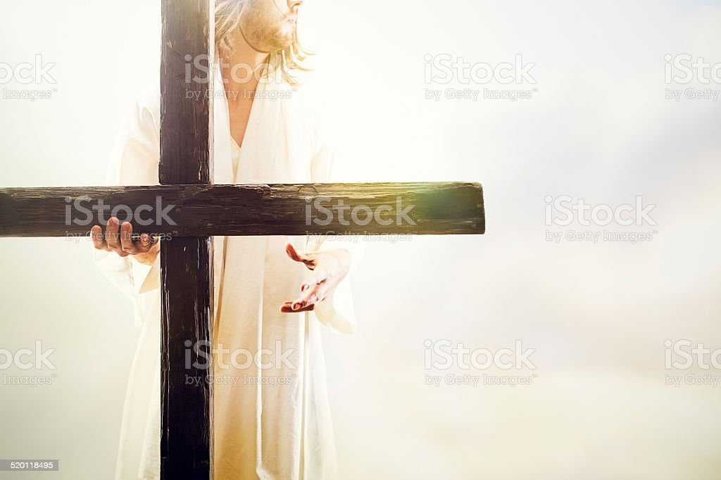 Jesus Christ Holding Cross stock photo