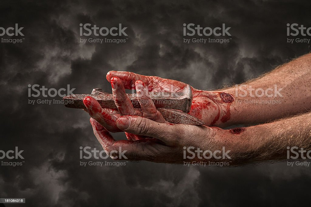 Jesus Christ holding the nails from his crucifixion stock photo