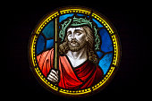 Colourful medieval stained glass window depicting Jesus Christ in crown of thorns made by an unknown author