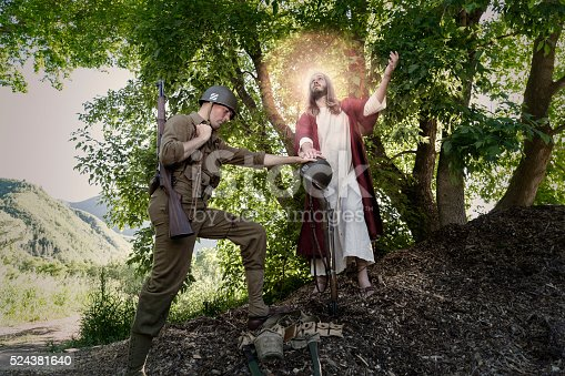 Jesus Christ looks up to the heavens while a soldier mourns over where his comrade lost his life.