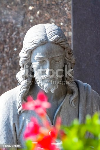 Front view of Jesus Christ, old marble statue from cemetery build in 1877 Czech Republic, vertical composition