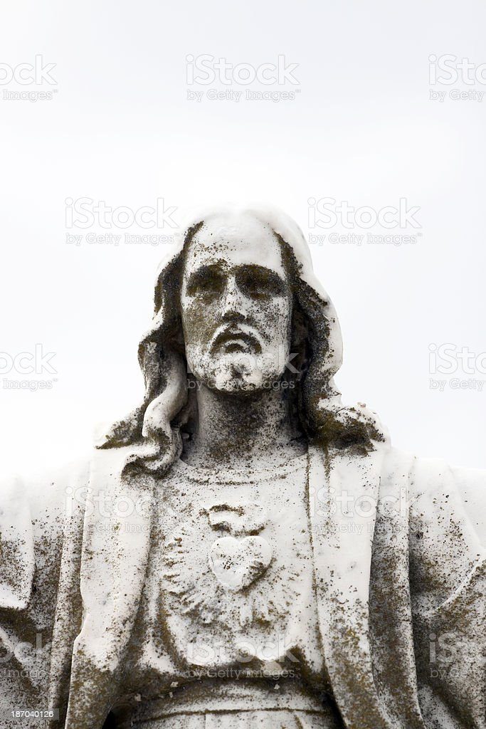 Jesus Christ, old weathered statue against white background, copy space royalty-free stock photo