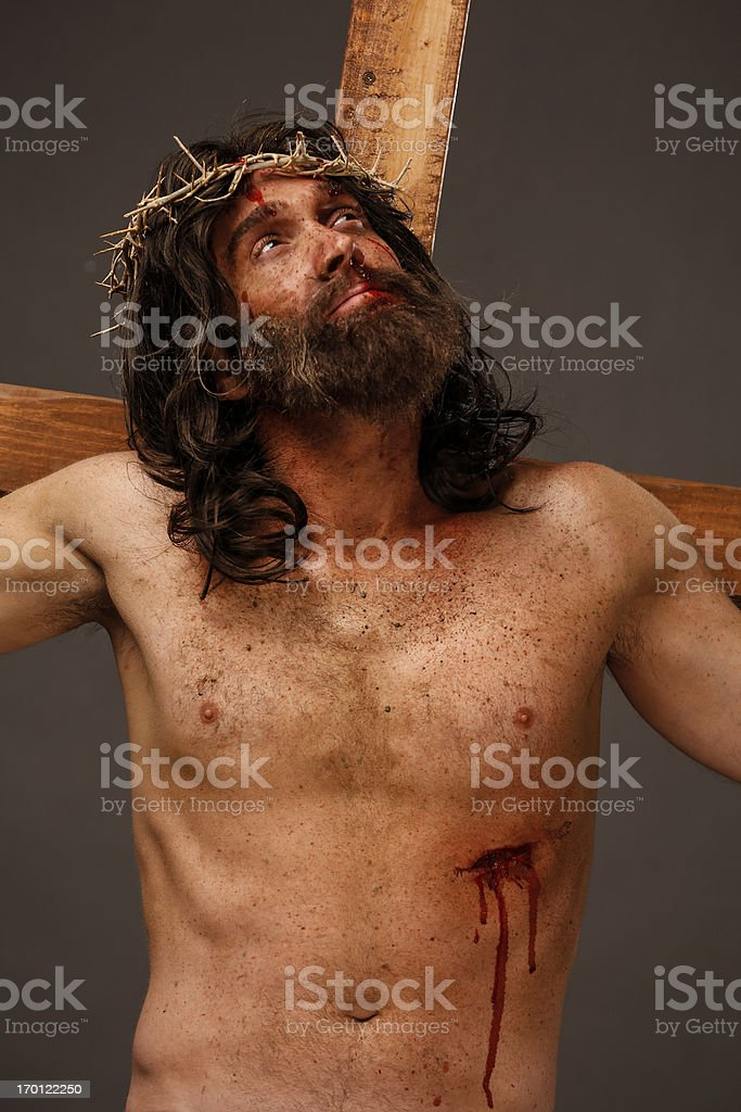Jesus Christ on cross looking up stock photo
