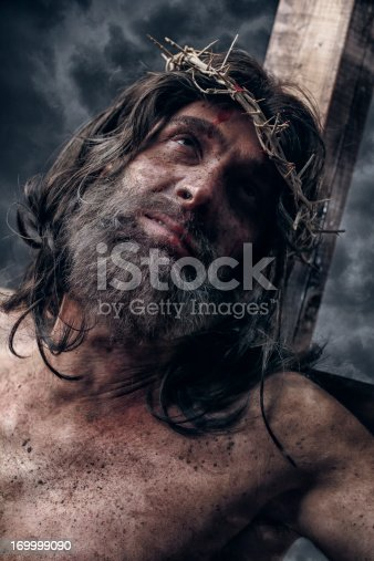 Jesus Christ on cross. This stock image has a vertical composition.