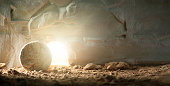 """istock Jesus Christ resurrection. Christian Easter concept. Empty tomb of Jesus with light. Born to Die, Born to Rise. """"He is not here he is risen"""". Savior, Messiah, Redeemer, Gospel. Alive. Miracle. 1243063764"""