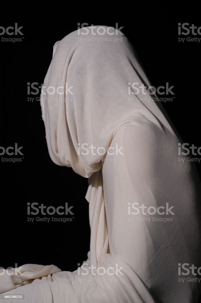 Jesus Christ rising from the dead wrapped in white cloth. Easter...