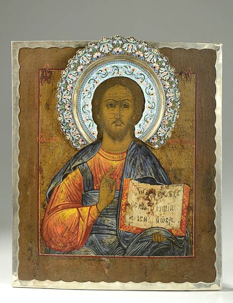 Jesus Christ Russian Icon/Plaque, 19th Century 19th century Russian icon depicting Jesus Christ holding scripture.  It is an oil on board has an emaneled riza/halo and silver border, set on a gradient background. religious symbol stock pictures, royalty-free photos & images