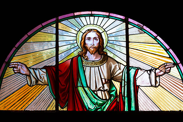 Jesus Christ, stained glass church window Stained glass window from 1854 of Jesus Christ with his arms outstretched, artist unknown, Czech Republic, full frame horizontal composition, copy space  Amen stock pictures, royalty-free photos & images