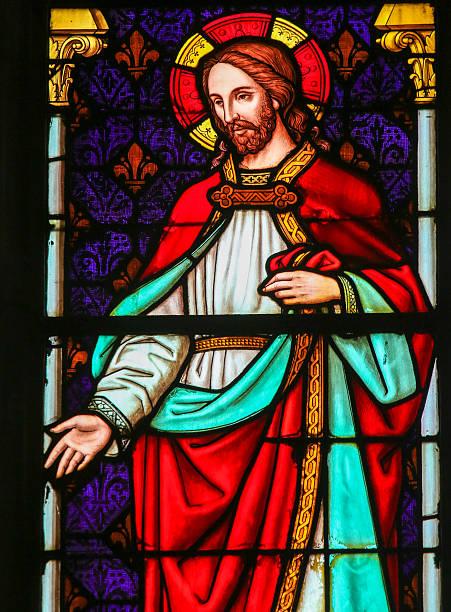 jesus christ - stained glass in mechelen cathedral - messias stock-fotos und bilder