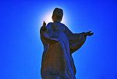 istock Jesus Christ statue light blue sky 1270352870