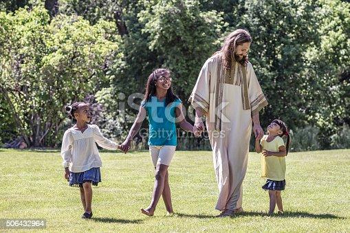 istock Jesus Christ Walking With Children - Three Young Girls 506432964