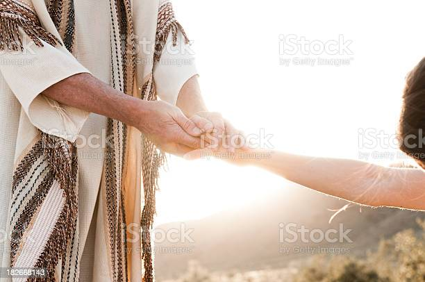 Jesus holding a woman's hand. Similar Images:
