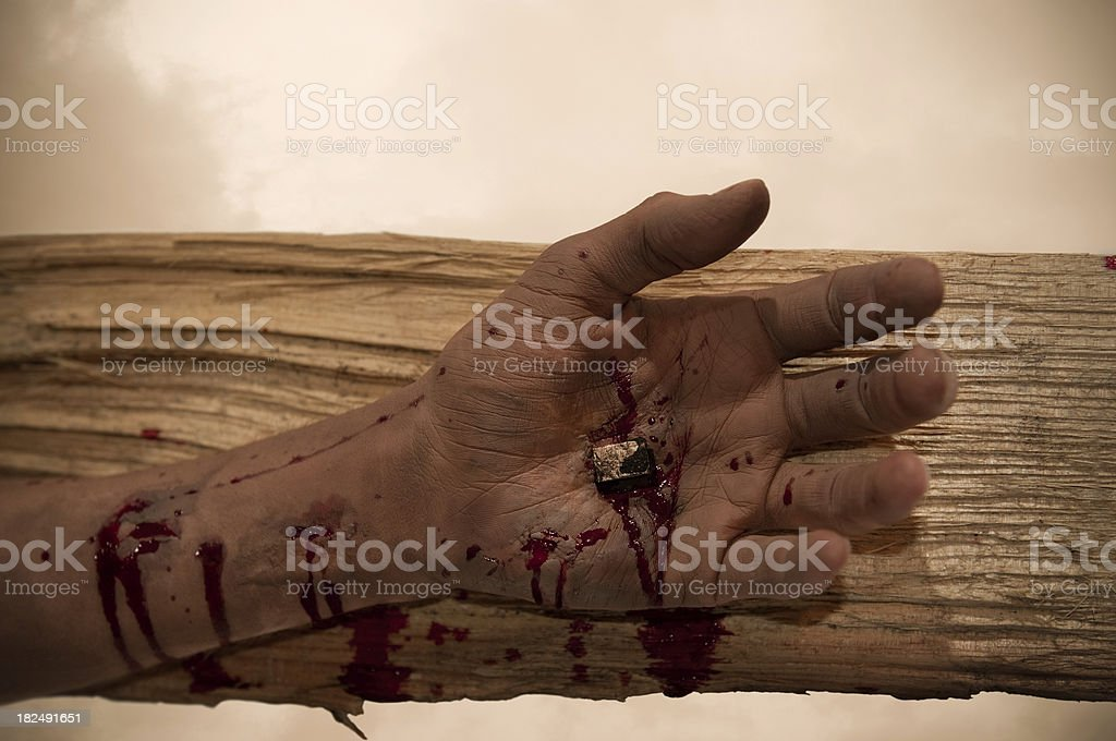 Jesus' Hand Nailed to the Cross stock photo