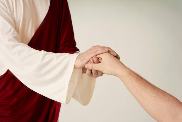 Jesus hand rescue and reaching humans one stock photo