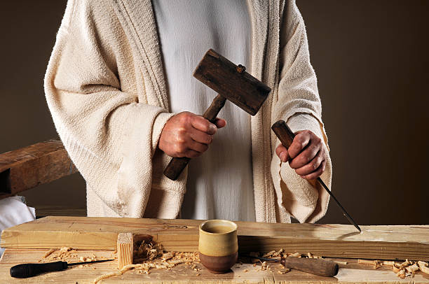 Jesus Hands With Carpenter's Tools stock photo
