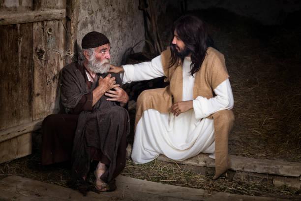 Jesus healing the lame old man stock photo