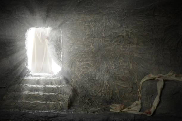 Jesus Leaving Empty Tomb Jesus leaving empty tomb while light shines from the outside tomb stock pictures, royalty-free photos & images